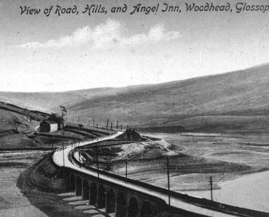 View of road, hills and Angel Inn